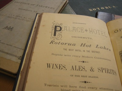 A selection of books about the Rotorua region including Terraces of Rotomahana (open) by Frank Cowan, 1885. (1989.83.2)